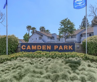 Camden Park – Image of the front entrance monument sitting on a bed of flowers.