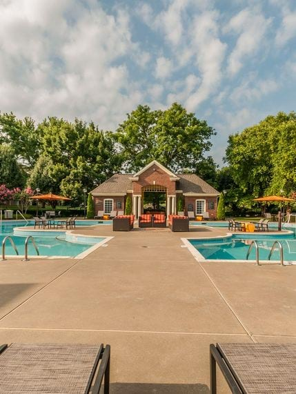 Cherry Creek Pool Area with Lounge chairs surrounded by beautiful landscaping