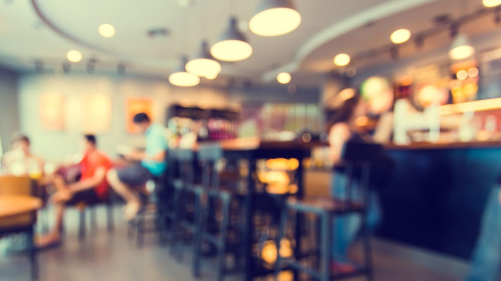 CEDAR CREEK - stock photo of people seated in a cafe