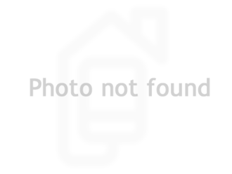 EL QUINTERO - stock photo of a living room with a couch, coffee table, and end table