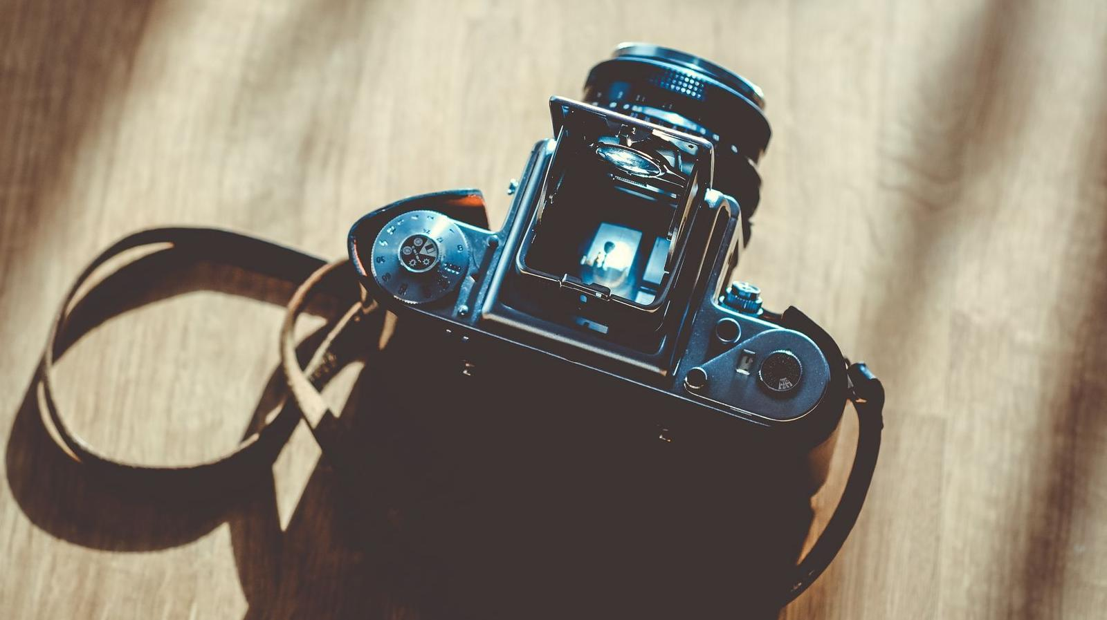 COURTYARD TERRACES -Stock photo of a camera sitting on a table