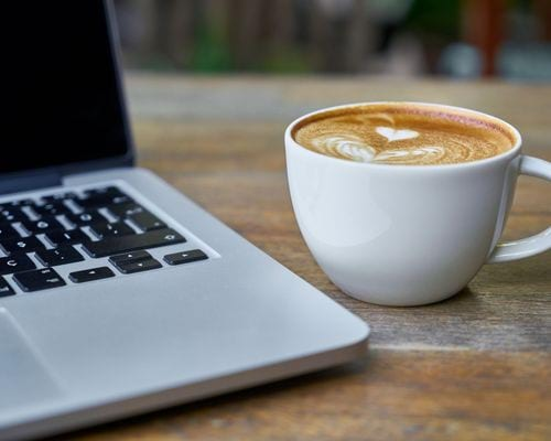 Ellery at Lake Sherwood - Lifestyle filler image of a laptop and a coffee cup on a table.