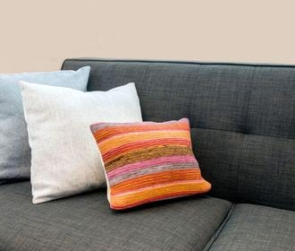 BRAWLEY GARDEN APARTMENTS - Stock photo of a couch with throw pillows