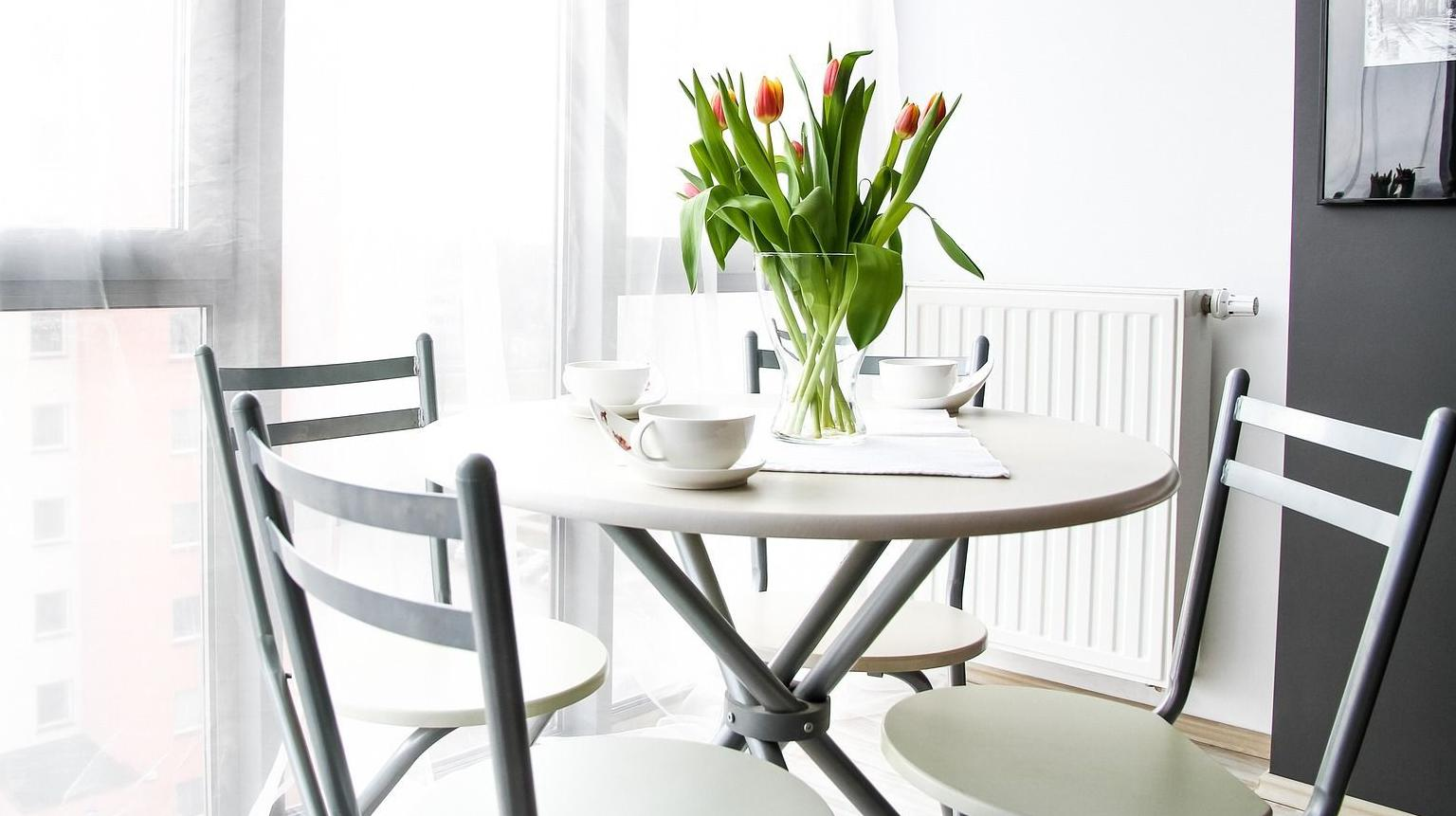 IRIS APARTMENTS -  stock photo of coffee table with 3 chairs, cups and flowers in a vase