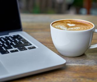 St. Regis Park - stock photo of a laptop and coffee cup on a desk