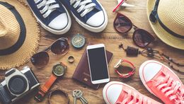 Stock image of shoes, cell phone, camera, and hats.