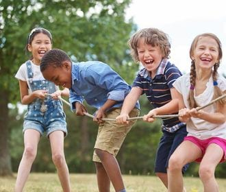 Villa Dorada - Stock photo of children playing tug of war