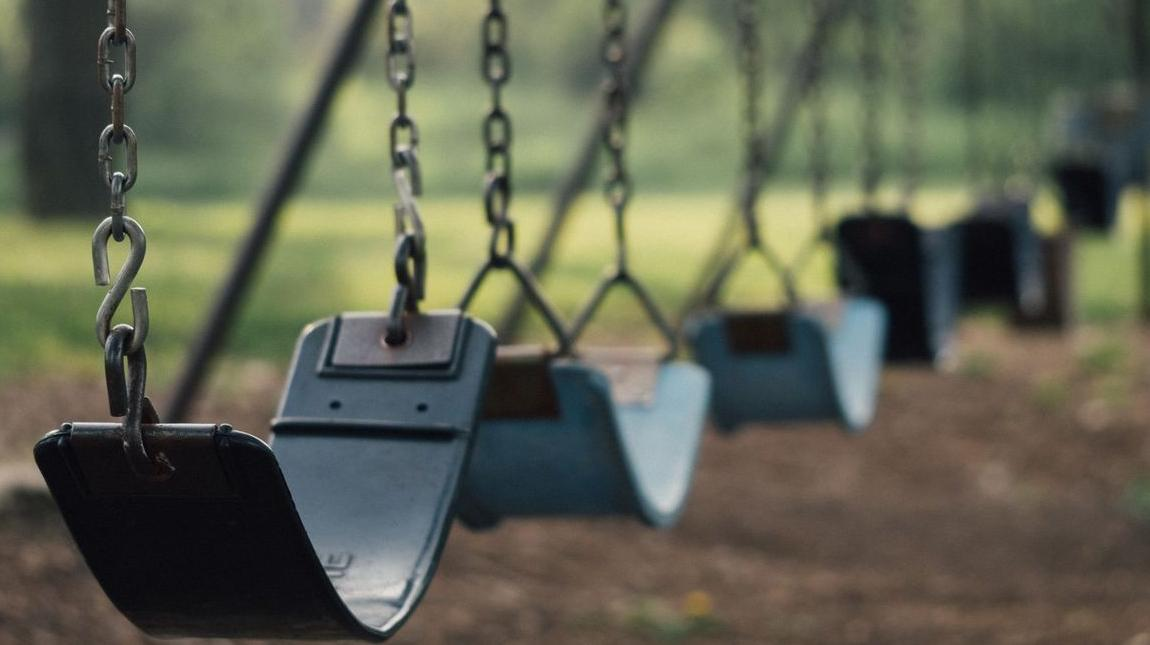 Seabreeze Farms - stock photo of swings on a playground