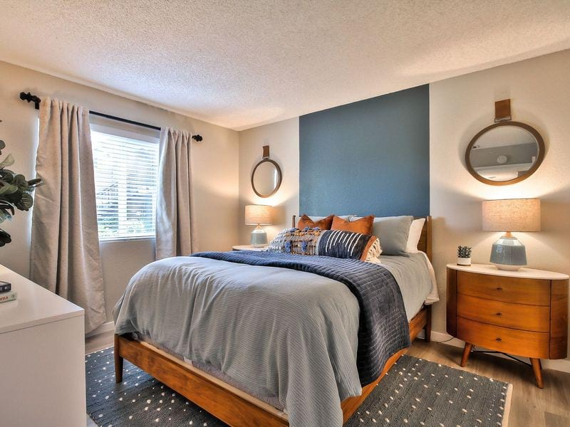 Bedroom furnished with bed, end table, and dresser.