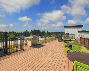 Image of Rooftop deck with seating areas and one grill station.