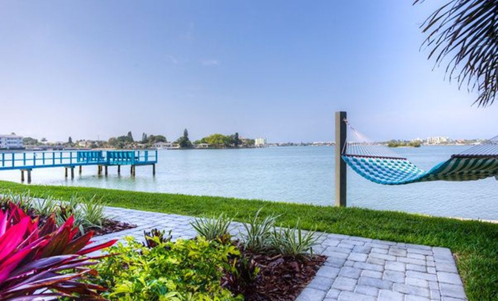 Bayside Villas - Image of the community hammocks located next to the water.