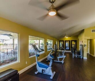 Full body work out center includes cardio, weight, and strength training equipment