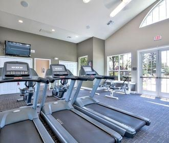 Full body work out center including weights, cardio, and strength training equipment.