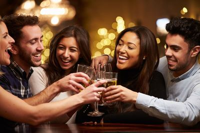 Stock image of friends at a bar