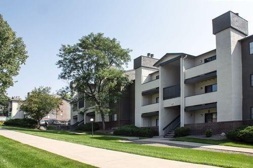 Avery Belmar - Image of the exterior of the garden style apartment building.