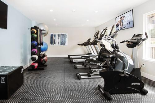 Avery Belmar - Image of the fitness center with cardio equipment.