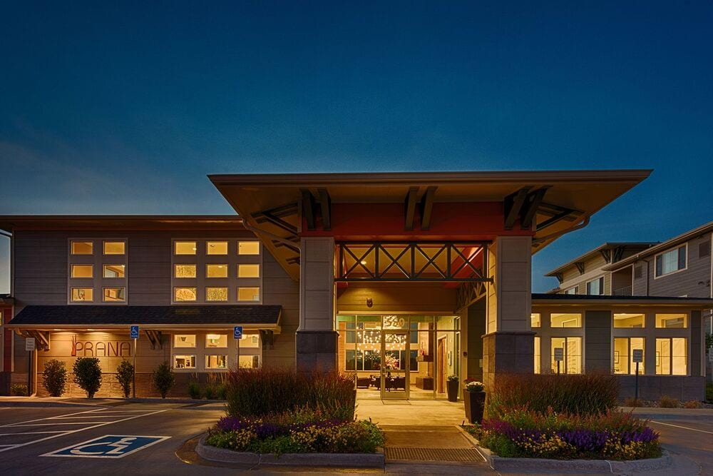 Prana Apartment Homes - Image of the leasing center at night.