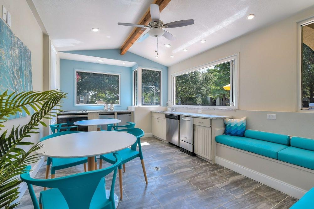 Sheridan Park at Spring Creek - Resident clubhouse kitchen with seating.