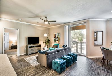 Ellery at Lake Sherwood - Spacious living room with wood-style vinyl plank flooring.