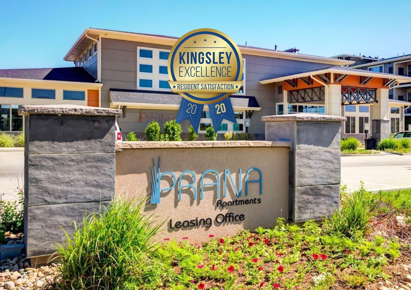 Prana Apartment Homes - Image of the front entrance monument sign with a Kingsley Excellence award graphic logo overlayed.