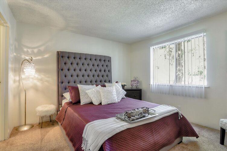 Image of spacious closet facing bedroom area.