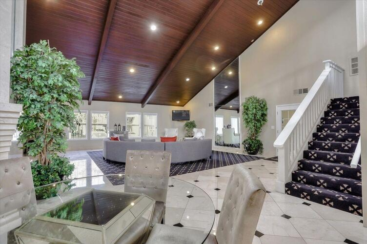 """alt=""""Image of spacious living room with wood vinyl flooring and access to patio. """""""