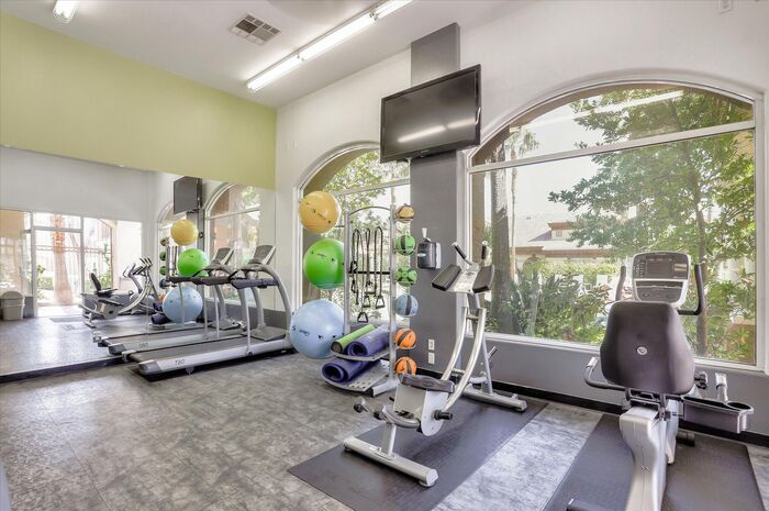 Full body work out center includes cardio and strength training equipment.