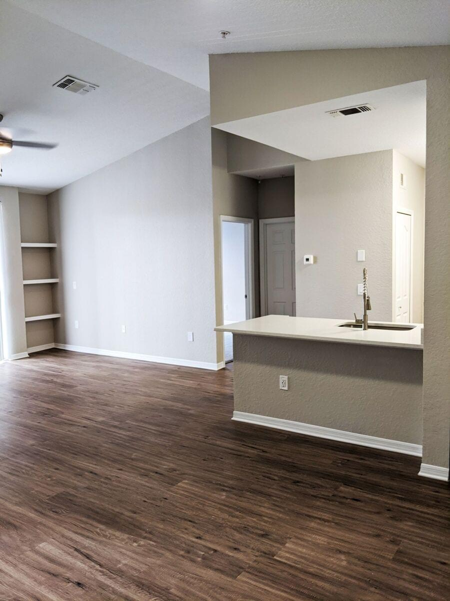 INDIGO WEST - Image of an upgraded living area with wood-style plank flooring.