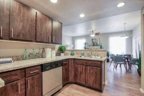 Kitchen with stainless steel appliances, granite counters, and espresso cabinets.