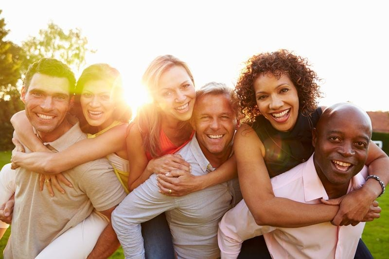 Stock image of six adults smiling.