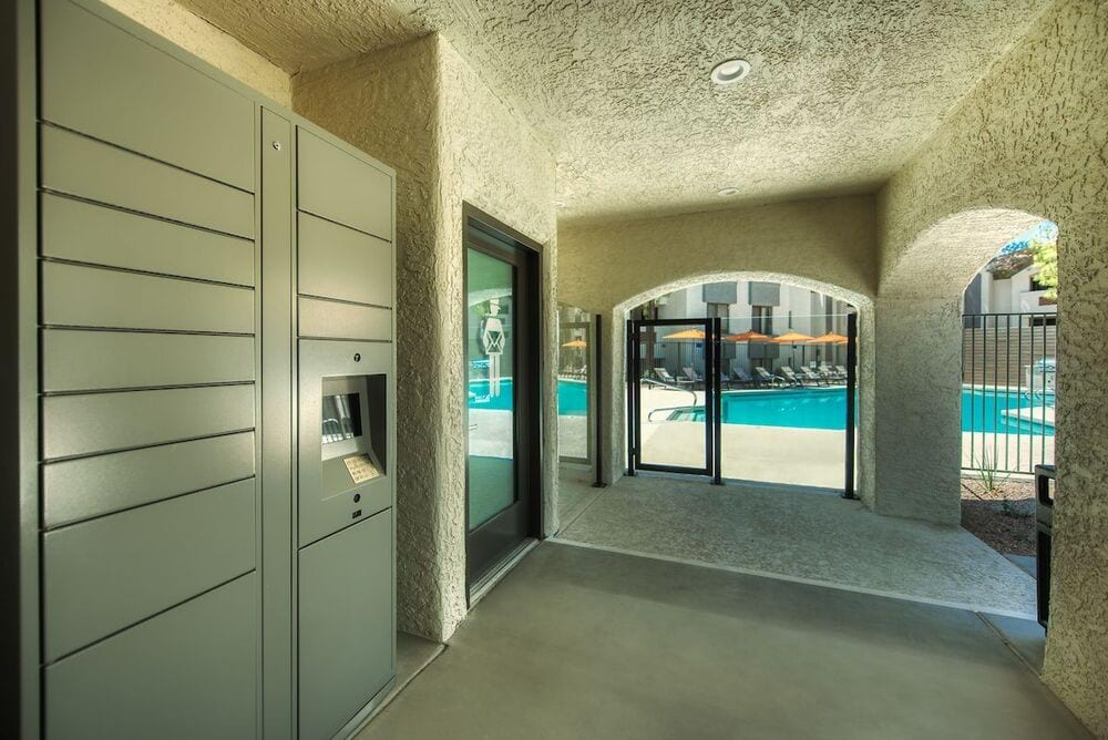 Package lockers and mail room with view to pool area.