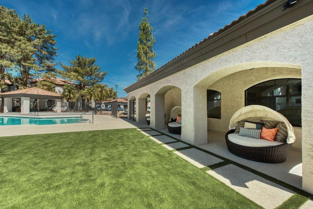 Pool area with lawn, outdoor lounge pods, and view to pool, spa, and gazebo.