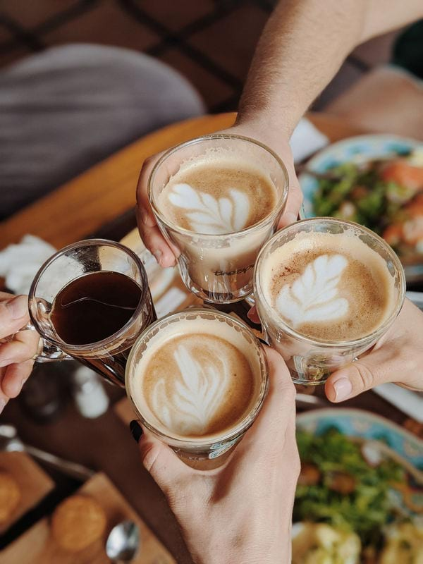 friends having a toast with coffee
